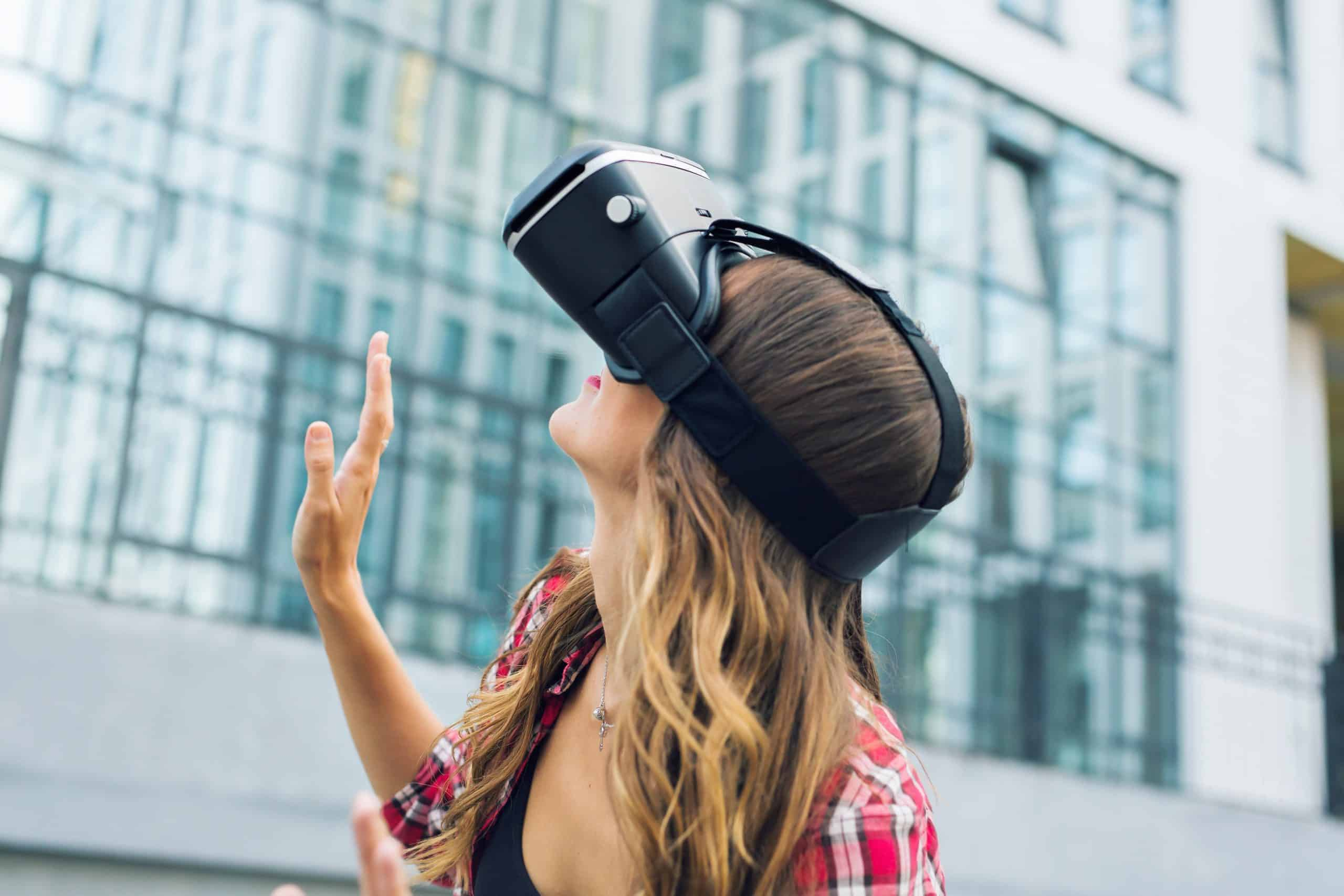beautiful young girl with virtual reality VR headset on the street.