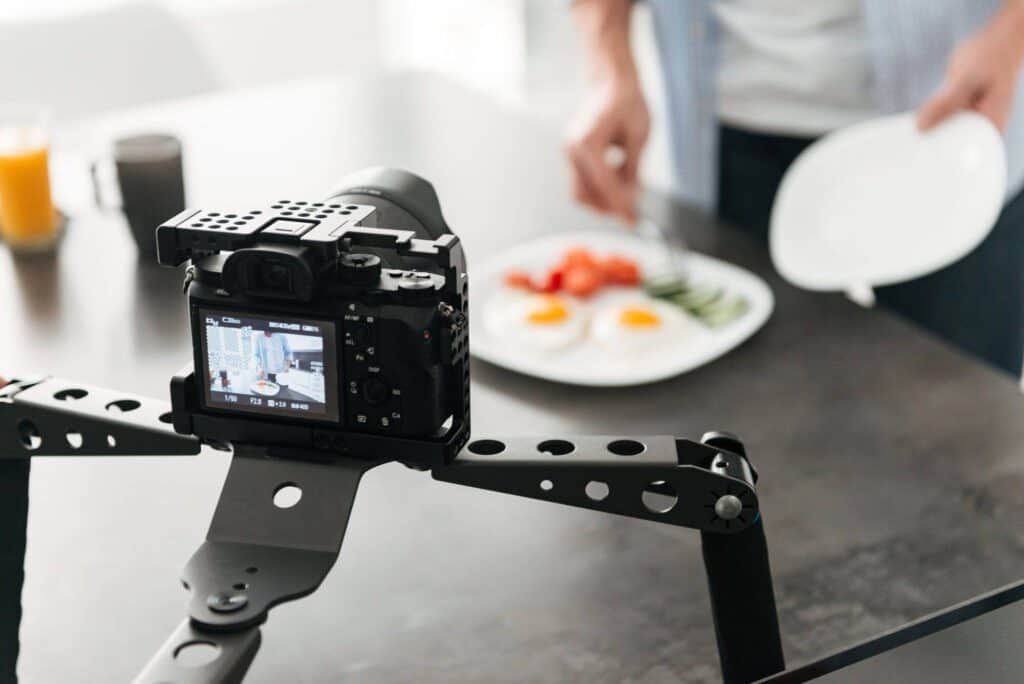 Man recording video food blog about cooking